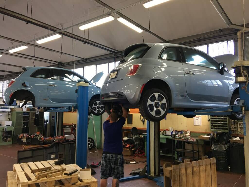 working on Fiat 500e in Italy